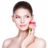 Beautiful young woman with pink rose. Stock Image