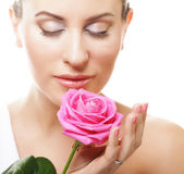 beautiful  young woman with pink rose Stock Photography