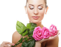 beautiful  young woman with pink rose Stock Image