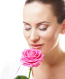 beautiful  young woman with pink rose Royalty Free Stock Photography