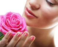 beautiful  young woman with pink rose Royalty Free Stock Images