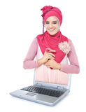 Beautiful young woman with pink scarf out of the laptop Royalty Free Stock Photo