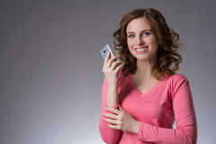 Beautiful young woman  in a pink shirt expresses emotions with s Stock Photo