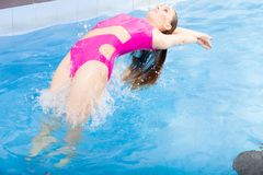 Beautiful woman swimming in pool Stock Photo