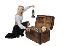 Woman pirate opening chest. Beautiful young woman pirate opening a treasure chest Stock Photography