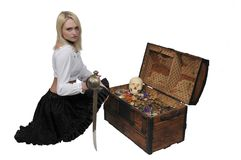 Woman pirate opening chest. Beautiful young woman pirate opening a treasure chest Stock Images