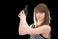 Beautiful young woman with pistol royalty free stock photos