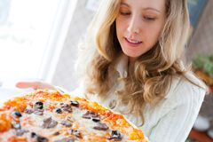 Beautiful young woman with pizza Royalty Free Stock Images