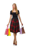 Beautiful young woman in plaid dress isolated on Royalty Free Stock Images