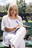 Beautiful young woman planning Royalty Free Stock Images