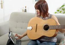 Beautiful young woman playing the acoustic guitar Royalty Free Stock Image