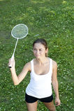 Beautiful Young Woman Playing Badminton. Green grass background Stock Photo