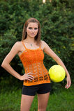 Beautiful young woman playing with ball outdoor in park Stock Photos