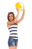 Beautiful young woman playing with a beach ball. Three quarter length studio shot isolated on white Royalty Free Stock Photos