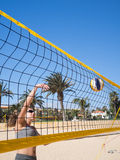 Beautiful young woman playing beachvolleyball Royalty Free Stock Images