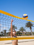 Beautiful young woman playing beachvolleyball Royalty Free Stock Photos