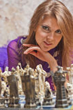 Beautiful young woman playing chess Royalty Free Stock Photo