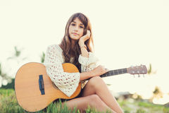 Beautiful young woman playing guitar on beach Royalty Free Stock Images
