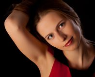 Beautiful young woman playing with her hair Stock Image