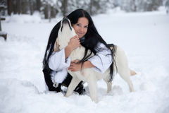 Beautiful young woman playing with labrador dog Royalty Free Stock Photography