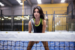Beautiful young woman playing paddle tennis indoor. Stock Image