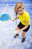 Beautiful young woman playing paddle tennis indoor. Stock Photography