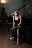 Beautiful Young Woman Playing the Piano Royalty Free Stock Images