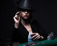 Beautiful young woman playing poker Royalty Free Stock Image