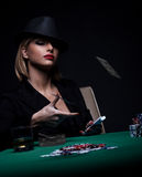 Beautiful young woman playing poker Royalty Free Stock Photos