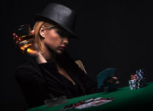 Beautiful Young Woman Playing Poker Royalty Free Stock Photo