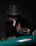 Beautiful young woman playing poker Royalty Free Stock Photography