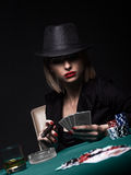 Beautiful young woman playing poker Royalty Free Stock Images