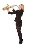 Beautiful young woman playing saxophone Stock Images