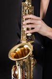 Beautiful young woman playing saxophone Royalty Free Stock Image