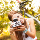 Beautiful young woman playing with a vintage camera Stock Images