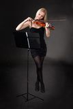 Beautiful young woman playing violin Stock Images