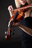 Beautiful young woman playing violin Royalty Free Stock Photography