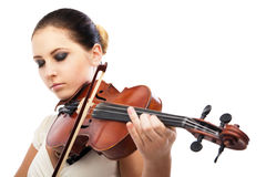 Beautiful young woman playing violin over white Royalty Free Stock Photos