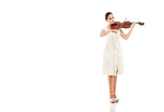 Beautiful young woman playing violin over white Royalty Free Stock Images