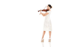 Beautiful young woman playing violin over white Stock Photography