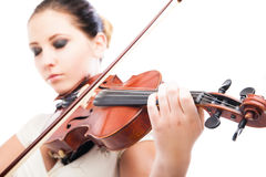 Beautiful young woman playing violin over white Royalty Free Stock Photo