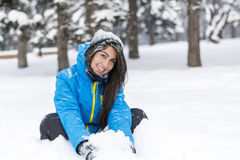 Beautiful young woman playing in  the winter mountain Royalty Free Stock Image
