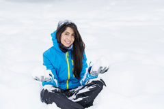 Beautiful young woman playing in  the winter mountain Royalty Free Stock Photo