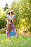 Beautiful young woman plays child Royalty Free Stock Images