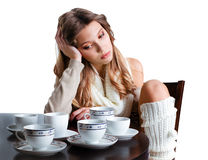 Beautiful young woman with plenty of coffee cups Royalty Free Stock Photography