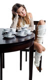 Beautiful young woman with plenty of coffee cups Royalty Free Stock Photos