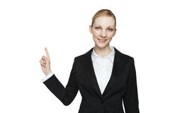 Beautiful young woman pointing Stock Photo