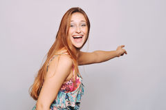 Beautiful young woman pointing. Stock Images