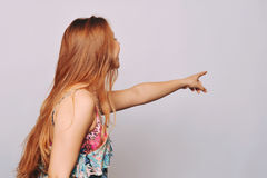 Beautiful young woman pointing. Royalty Free Stock Photos