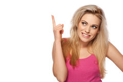 Beautiful young woman pointing her finger Royalty Free Stock Photo